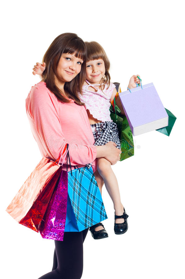 Muchacha con un niño con compras fotos de archivo