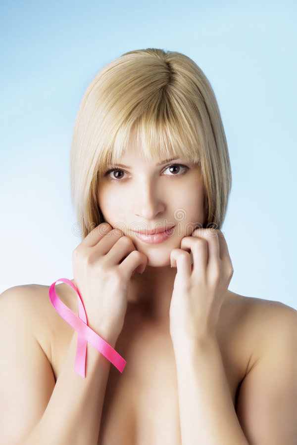 Muchacha con una cinta rosada fotos de archivo libres de regalías