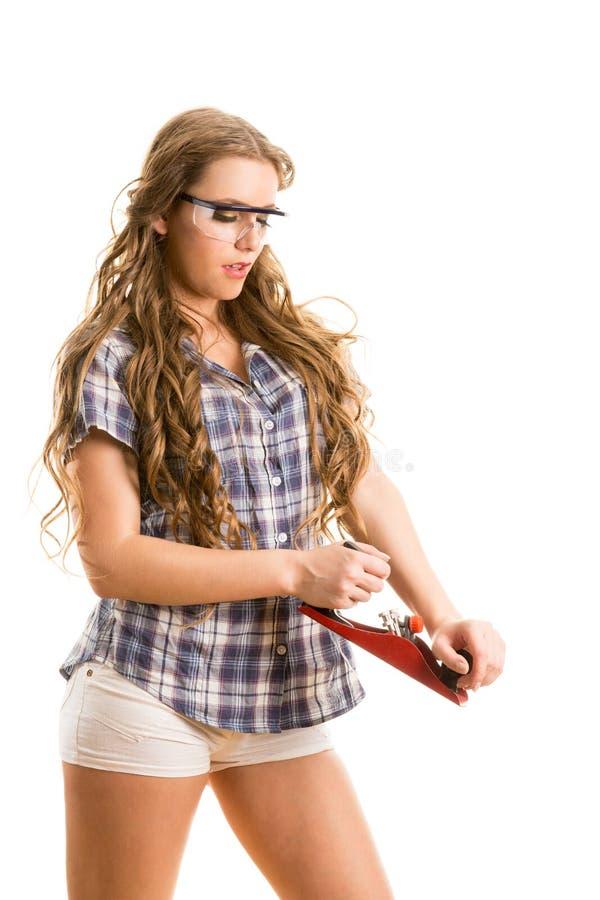 Muchacha con una ensambladora fotografía de archivo
