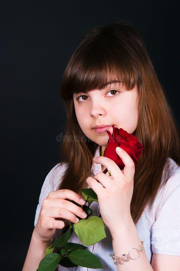 Muchacha con una rosa fotografía de archivo