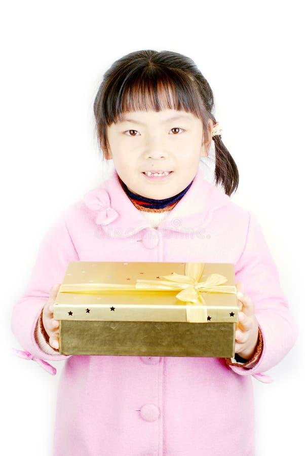Download Muchacha De Asia Con El Regalo En Manos Imagen de archivo - Imagen de víspera, golden: 7281483