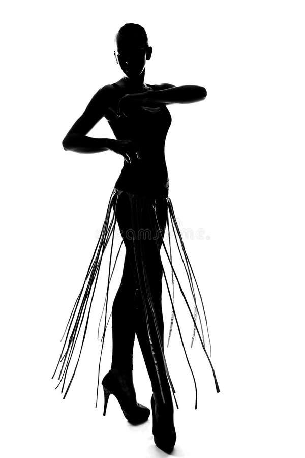 Muchacha de baile de moda de la silueta imagenes de archivo
