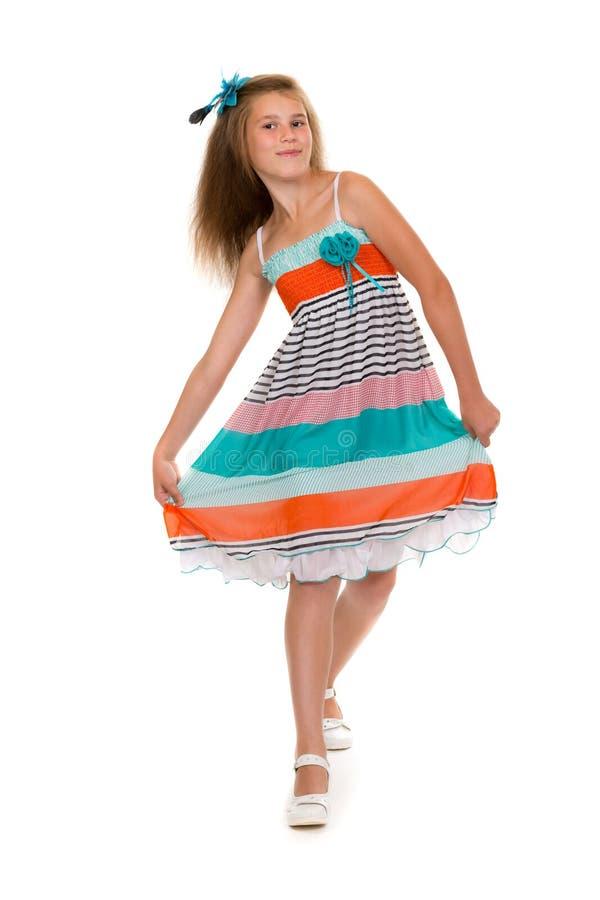 Muchacha de baile en un vestido en el estudio imagenes de archivo