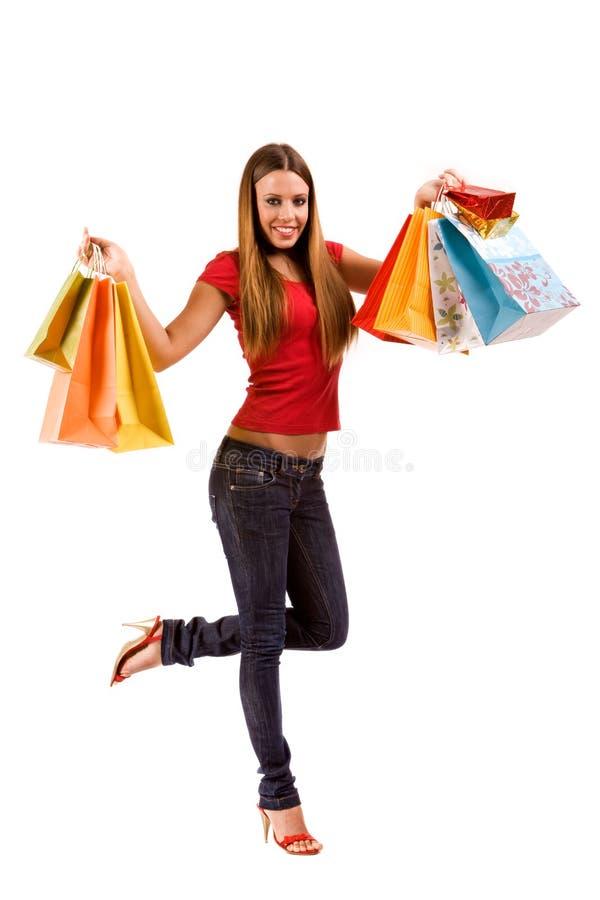 Muchacha de compras atractiva con los bolsos coloridos fotos de archivo