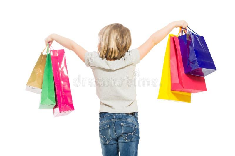 Muchacha de compras joven y rubia de detrás imagenes de archivo