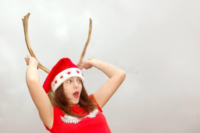 Muchacha de cuernos de Santa sorprendida fotos de archivo libres de regalías