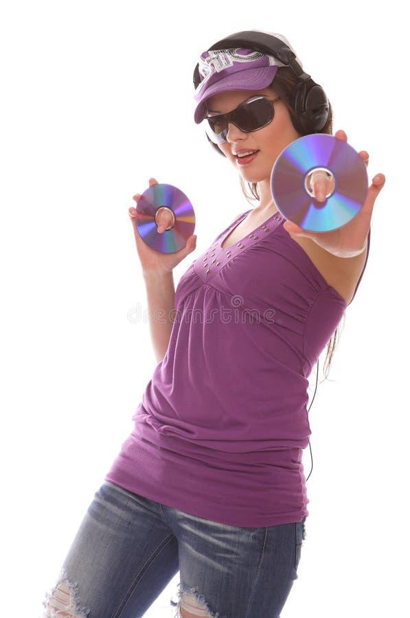 Muchacha de DJ con Cdes imagenes de archivo