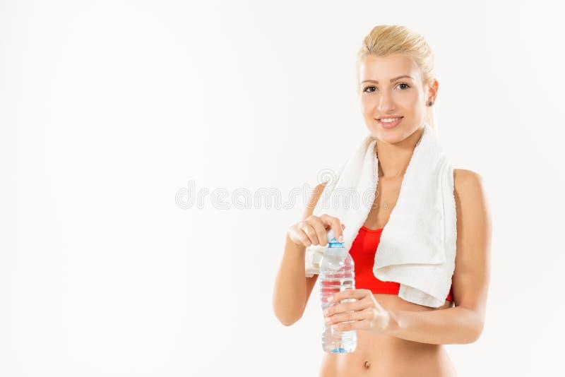 Muchacha de la aptitud con la botella de agua fotos de archivo
