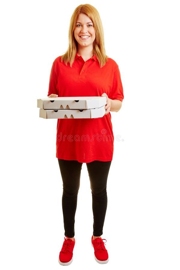 Muchacha de la entrega de la pizza con dos pizzas fotografía de archivo