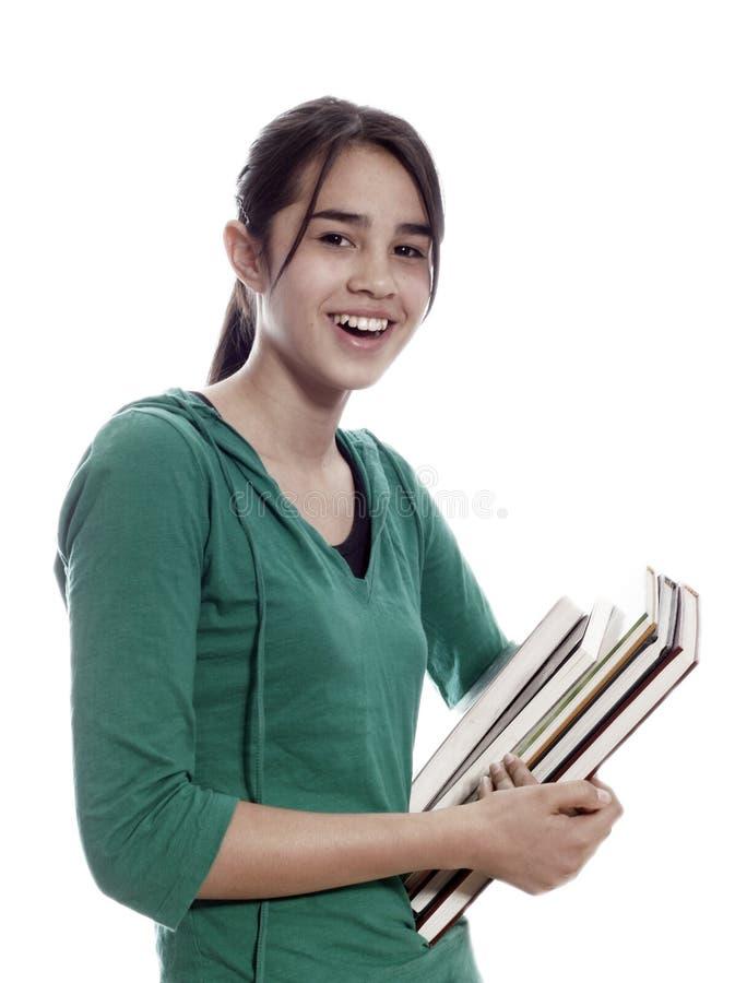 Muchacha de la escuela con los libros foto de archivo libre de regalías