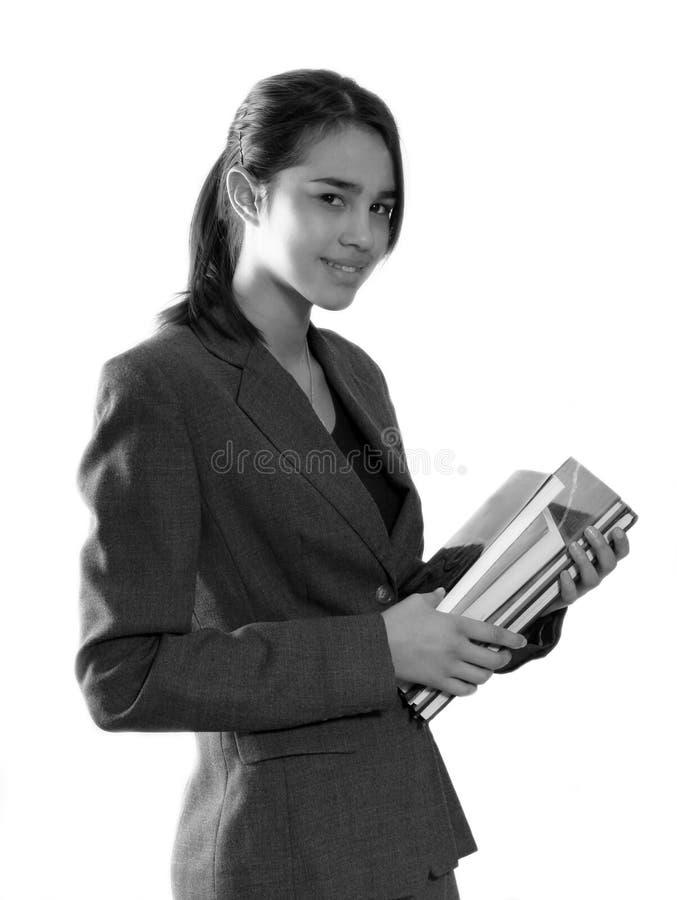 Muchacha de la escuela con los libros foto de archivo