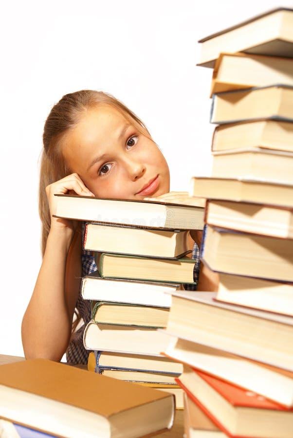 Muchacha de la escuela con los libros fotografía de archivo libre de regalías