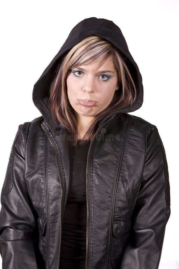 Muchacha de la expresión triste en chaqueta negra foto de archivo libre de regalías
