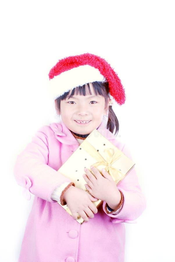 Download Muchacha De La Navidad Con El Regalo En Brazos Foto de archivo - Imagen de rojo, celebre: 7283054