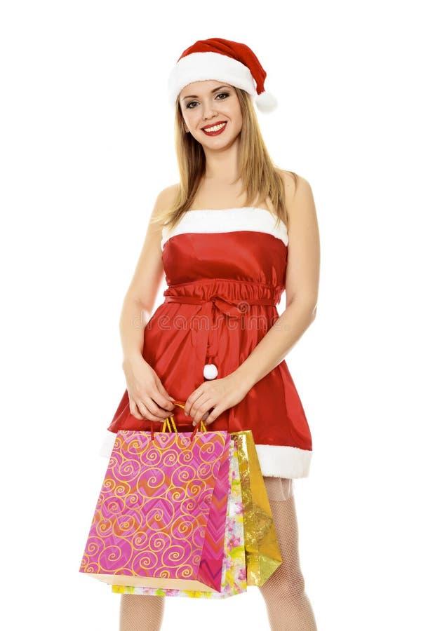 Muchacha de la Navidad con los bolsos coloridos imágenes de archivo libres de regalías
