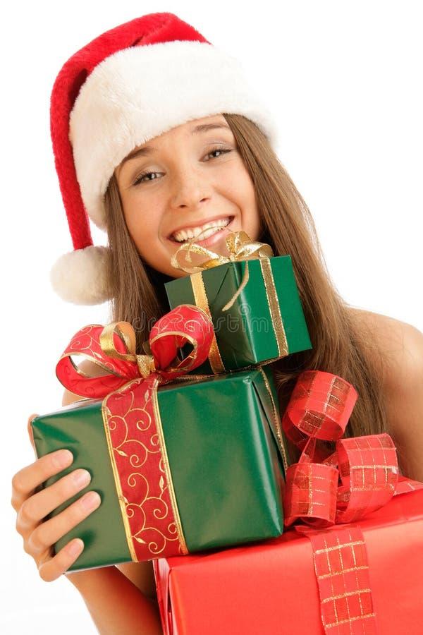 Muchacha de la Navidad con los regalos fotografía de archivo libre de regalías