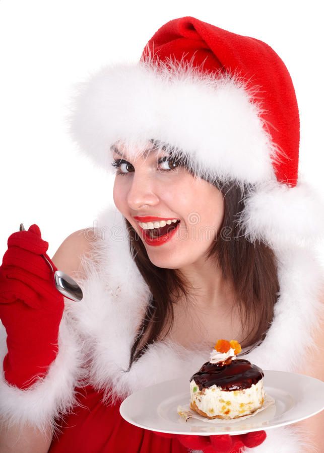 Muchacha de la Navidad en el sombrero y la torta de santa en la placa. imagenes de archivo