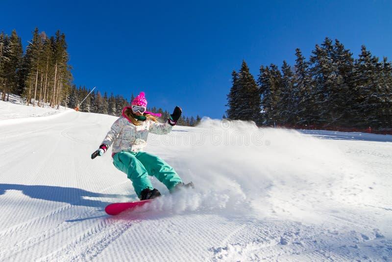 Muchacha de la snowboard imagenes de archivo