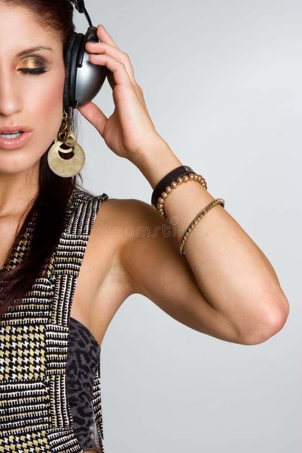 Muchacha de los auriculares imagen de archivo libre de regalías