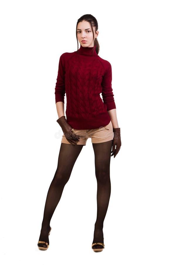 Muchacha de moda en rojo sobre blanco fotos de archivo libres de regalías
