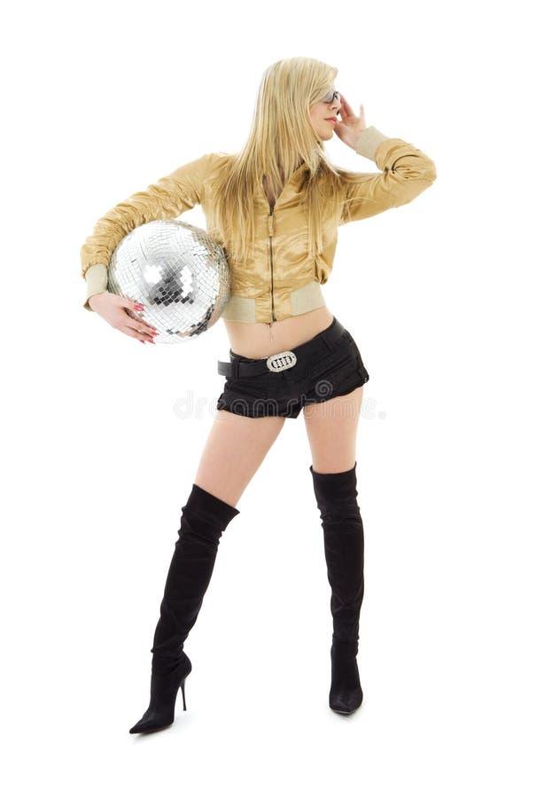 Muchacha de oro de la chaqueta con la bola del disco fotografía de archivo