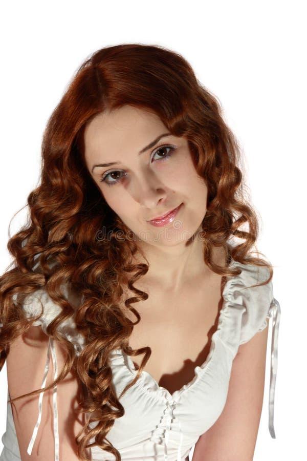 Muchacha de pelo largo rizada imagen de archivo