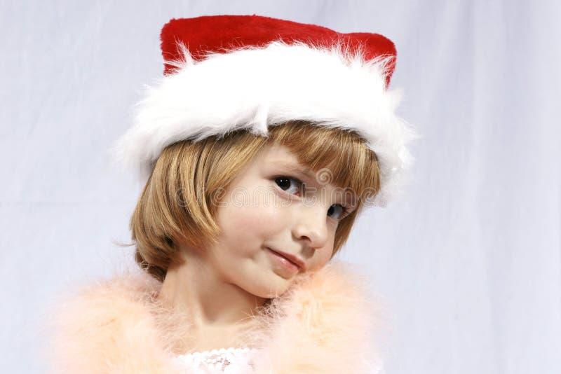 Muchacha de Redhair en el sombrero de Santa foto de archivo