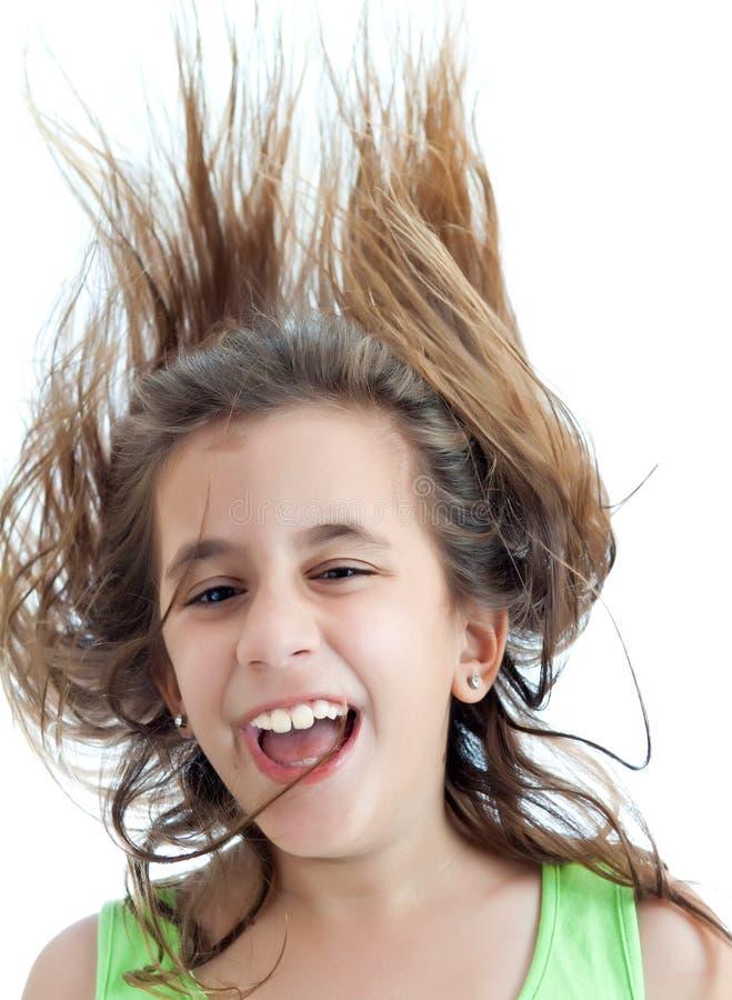Muchacha de risa con el pelo flotante aislado en blanco imágenes de archivo libres de regalías