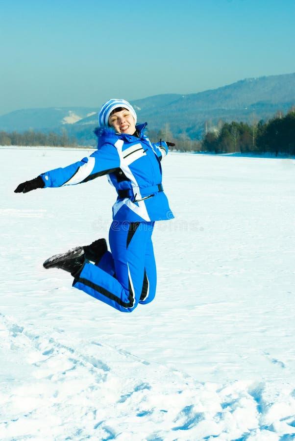 Muchacha de salto feliz imagen de archivo libre de regalías