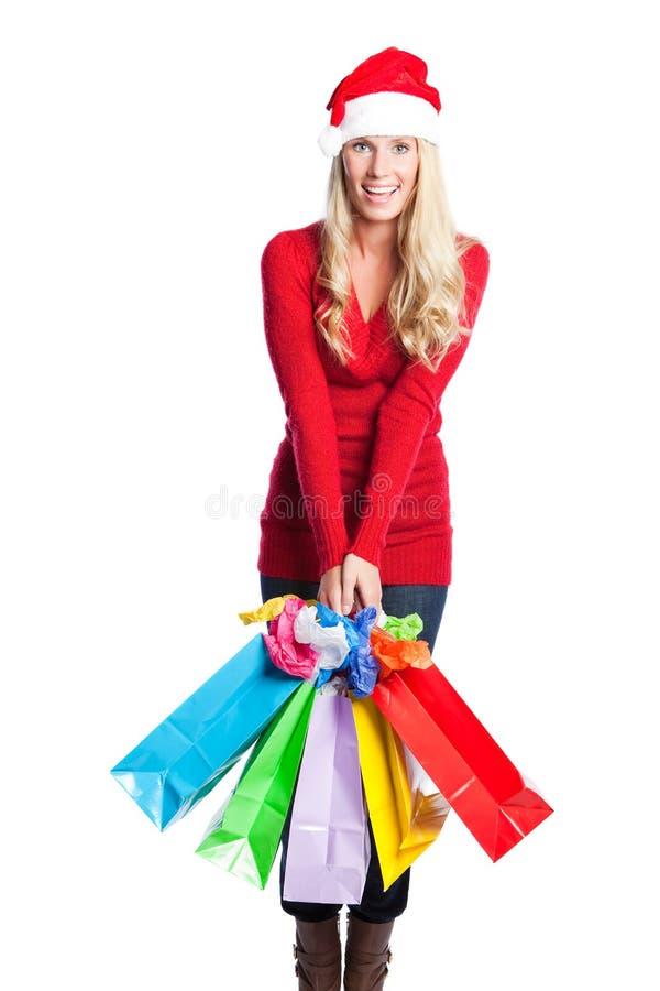Muchacha de santa de las compras de la Navidad fotografía de archivo