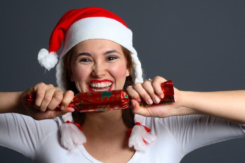 Muchacha de Santa que tira de la galleta fotos de archivo libres de regalías