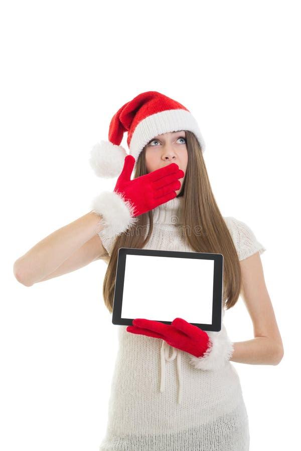 Muchacha de Sleeepy Papá Noel que muestra la tableta con la pantalla en blanco imágenes de archivo libres de regalías