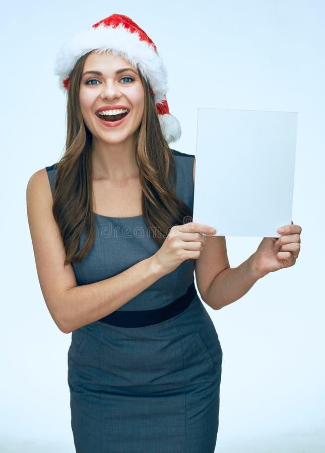 Muchacha de Smling santa que lleva a cabo el tablero en blanco blanco de la muestra fotografía de archivo
