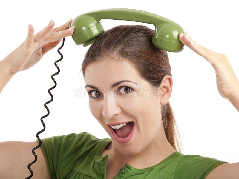 Muchacha de teléfono tonta imagen de archivo