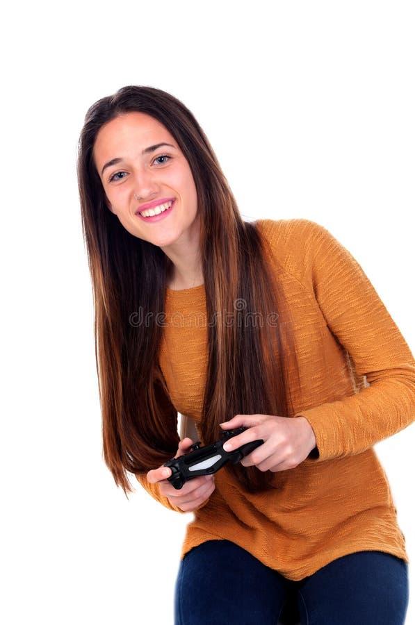 Muchacha del adolescente que juega con una palanca de mando foto de archivo libre de regalías