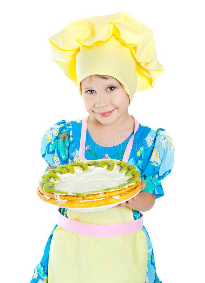 Muchacha del cocinero que sostiene una torta fotografía de archivo libre de regalías