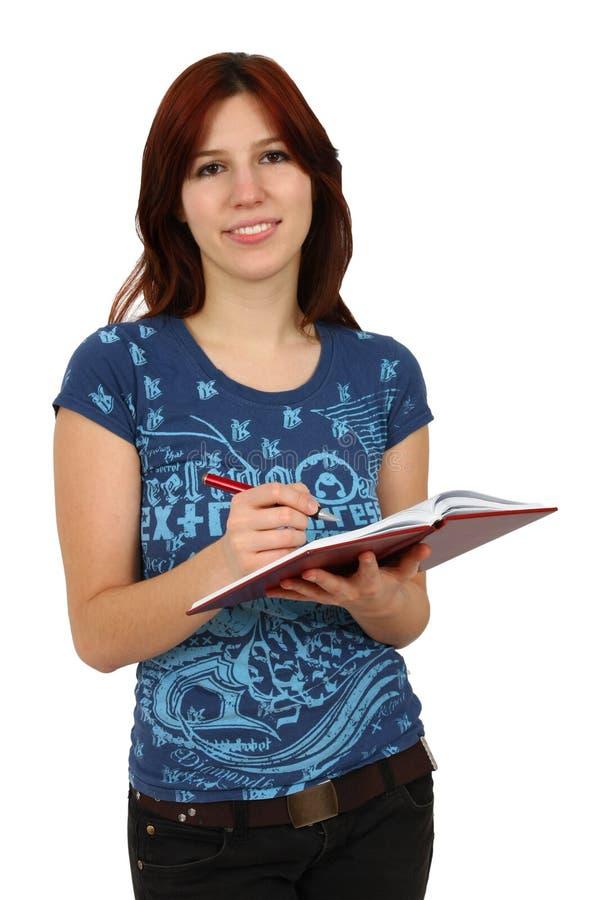 Muchacha del estudiante con los libros aislados fotos de archivo