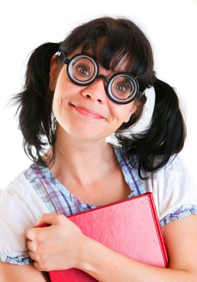 Muchacha del estudiante del empollón con los libros de textos imagen de archivo