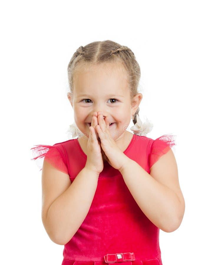 Muchacha del niño con las manos cerca de la cara aislada imagenes de archivo