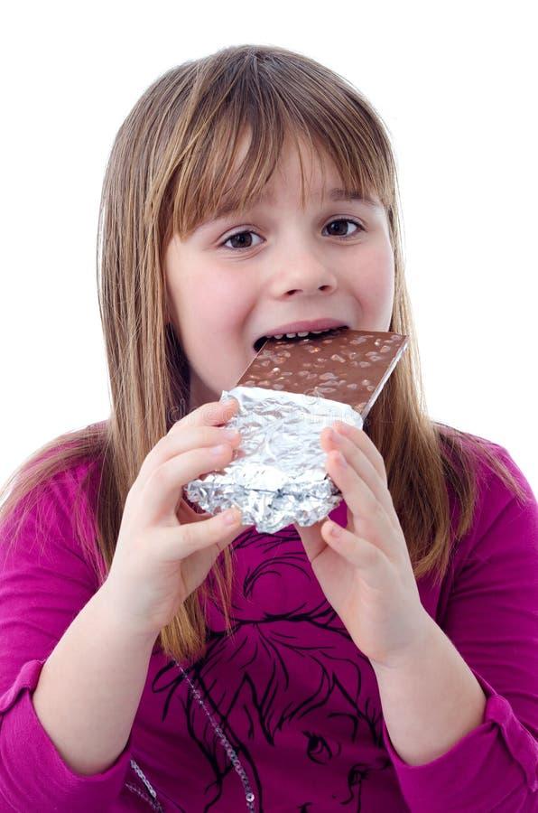 Muchacha Del Niño Que Come El Chocolate Fotos de archivo libres de regalías