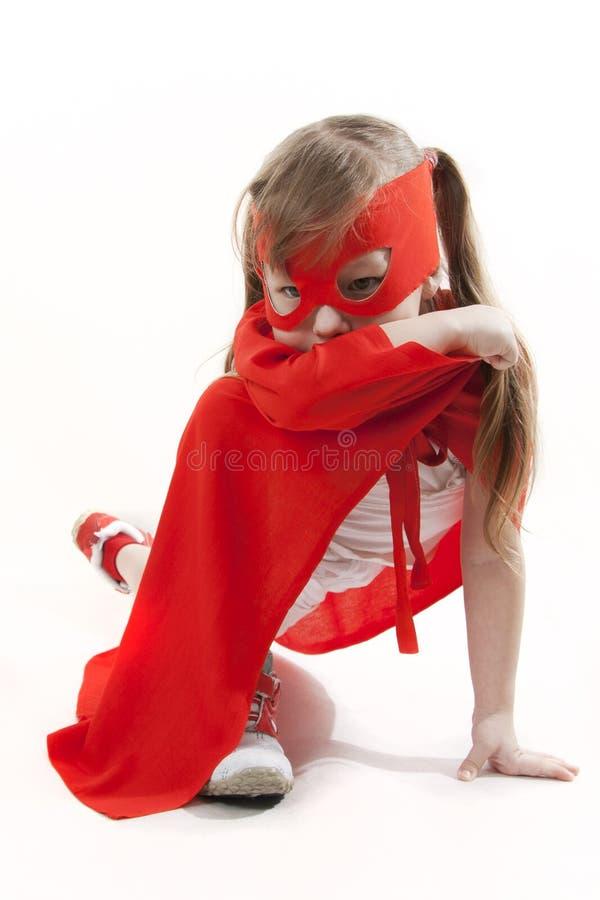 Muchacha del super héroe en un rojo imágenes de archivo libres de regalías
