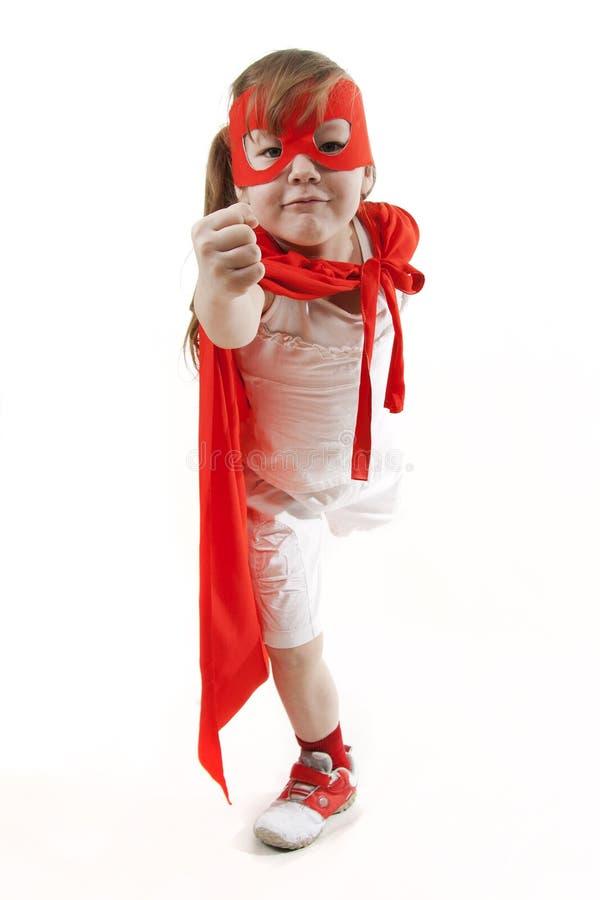 Muchacha del super héroe en un rojo fotos de archivo libres de regalías