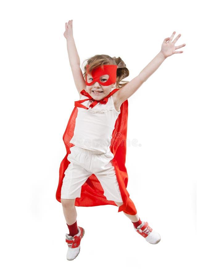 Muchacha del super héroe en un rojo fotos de archivo