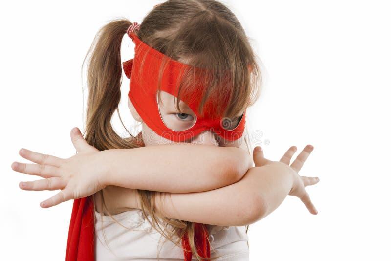 Muchacha del super héroe en un rojo imagenes de archivo