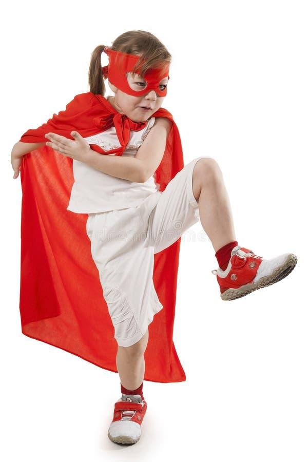 Muchacha del super héroe en un rojo imagen de archivo libre de regalías