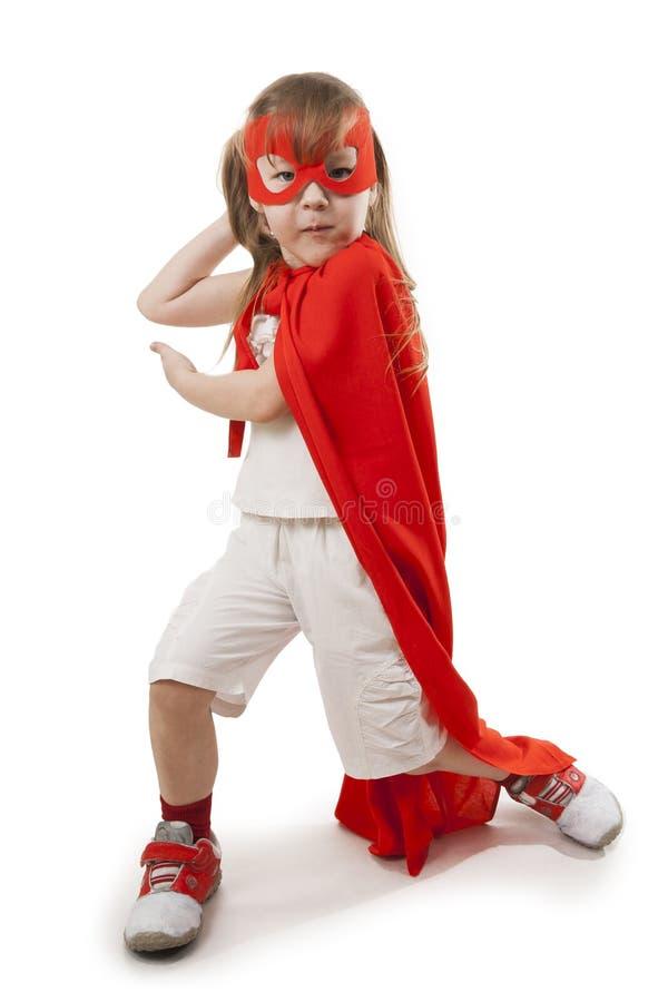 Muchacha del super héroe en un rojo fotografía de archivo libre de regalías