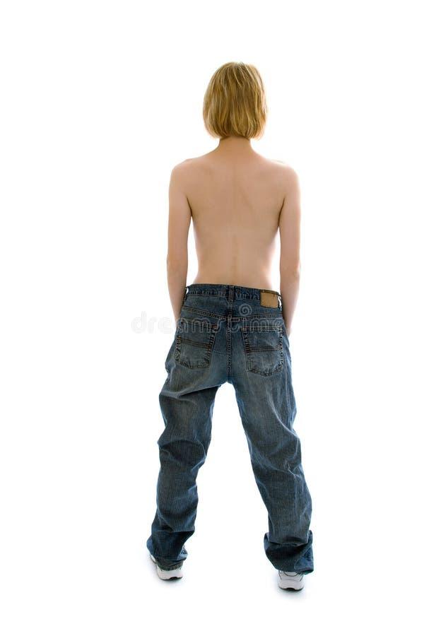 Muchacha delgada en pantalones vaqueros grandes de la talla imagenes de archivo