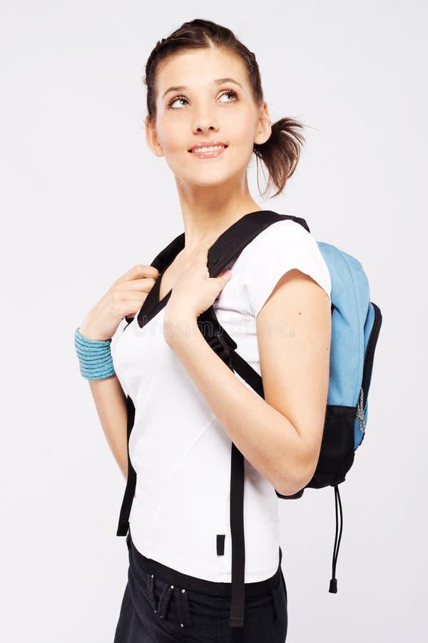 Muchacha deportiva linda con la mochila imagen de archivo libre de regalías