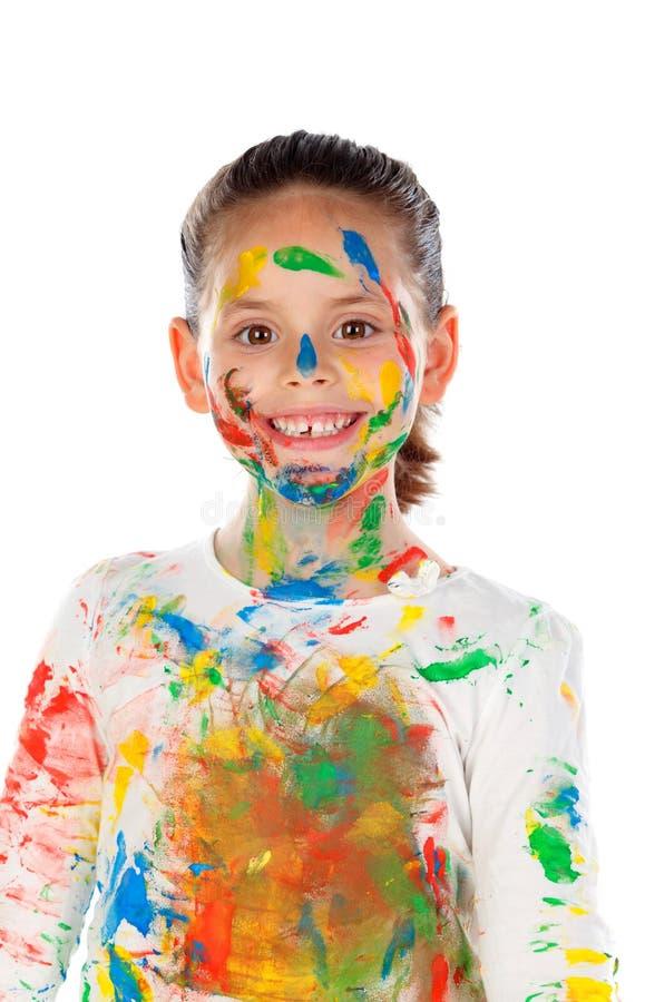 Muchacha divertida con las manos y la cara por completo de la pintura imagenes de archivo