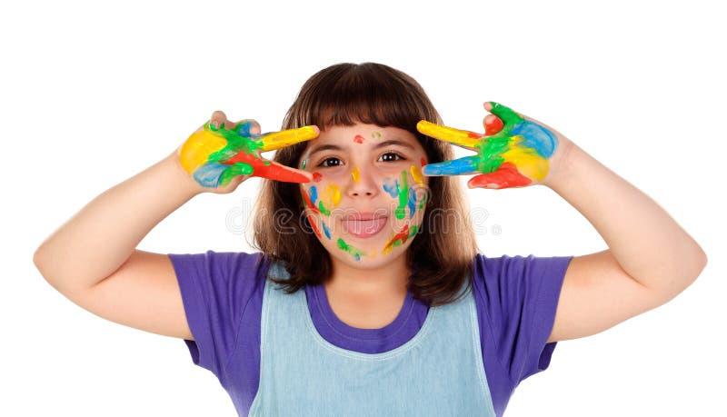 Muchacha divertida con sus manos sucias de la pintura imagen de archivo